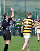 15 Colaiste Eoin Colm Mac Giolla Phadraig get a yellow card from ref Daivd Hickey